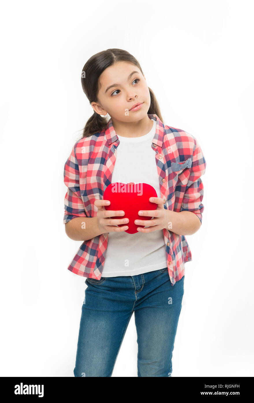 Red heart attribute of valentine. Heart gift or present. Me to you. Greeting from sincere heart. Girl cute child hold heart symbol love. Celebrate valentines day. Love and romantic feelings concept. - Stock Image
