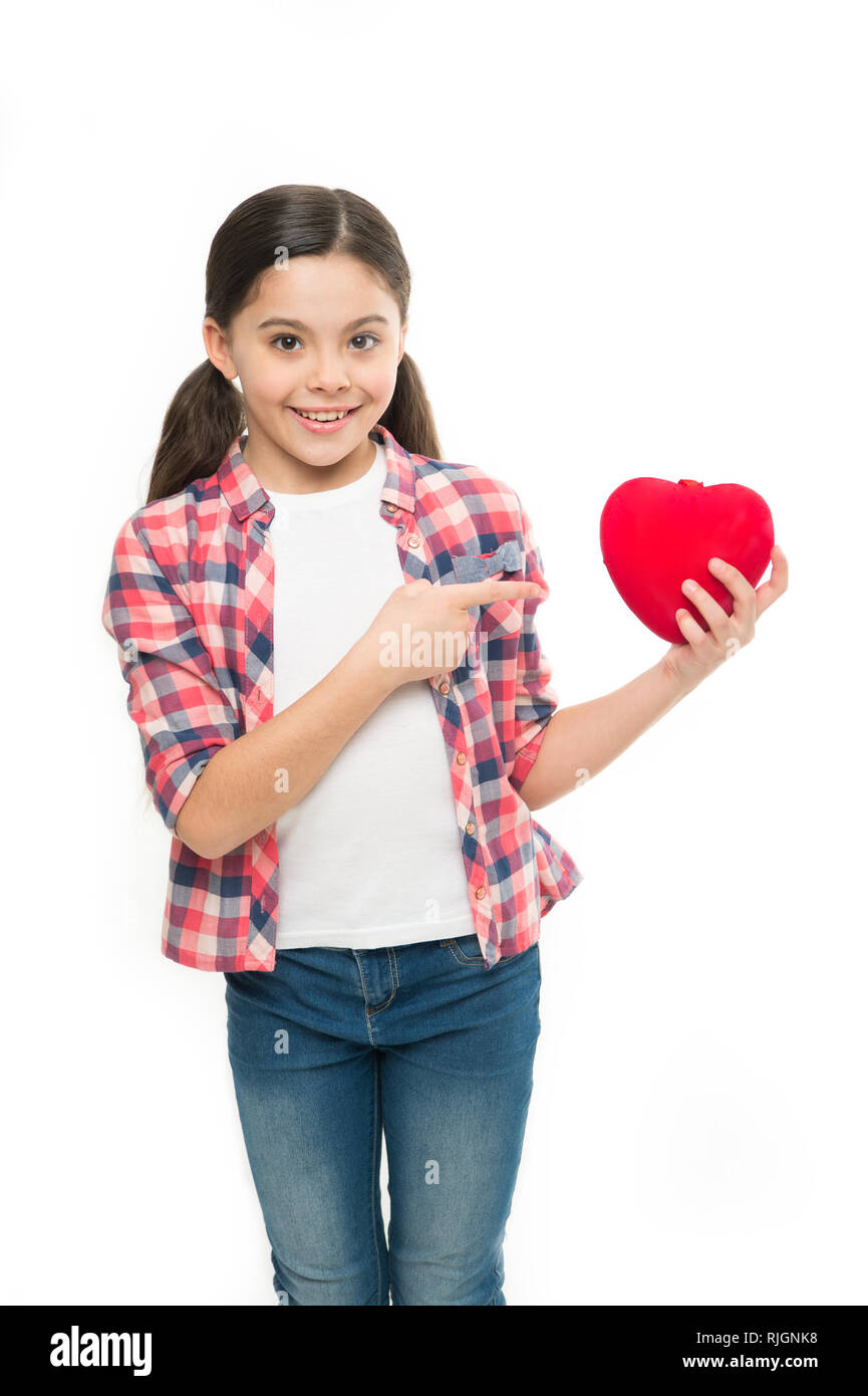Celebrate valentines day. Love and romantic feelings concept. Red heart attribute of valentine. Heart gift or present. Me to you. Greeting from sincere heart. Girl cute child hold heart symbol love. - Stock Image
