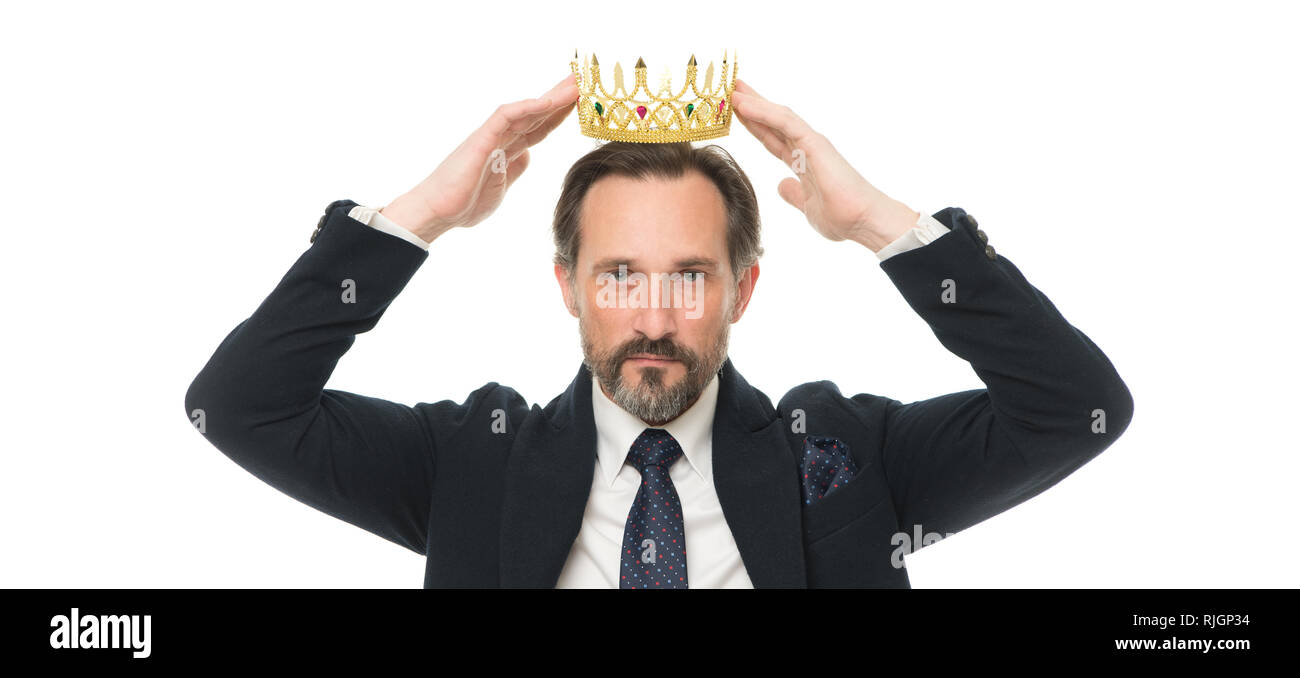 Monarchy family traditions. Man nature bearded guy in suit hold golden crown symbol of monarchy. Direct line to throne. Enormous privilege. Become king ceremony. King attribute. Become next king. - Stock Image