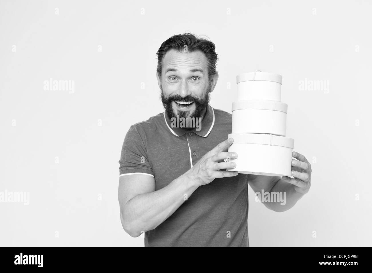 Is it all for me. Presents make life more interesting. Man mature bearded cheerful face holds pile boxes. Man got unexpectable gifts. Guy touched by attention and gifts for him yellow background. - Stock Image