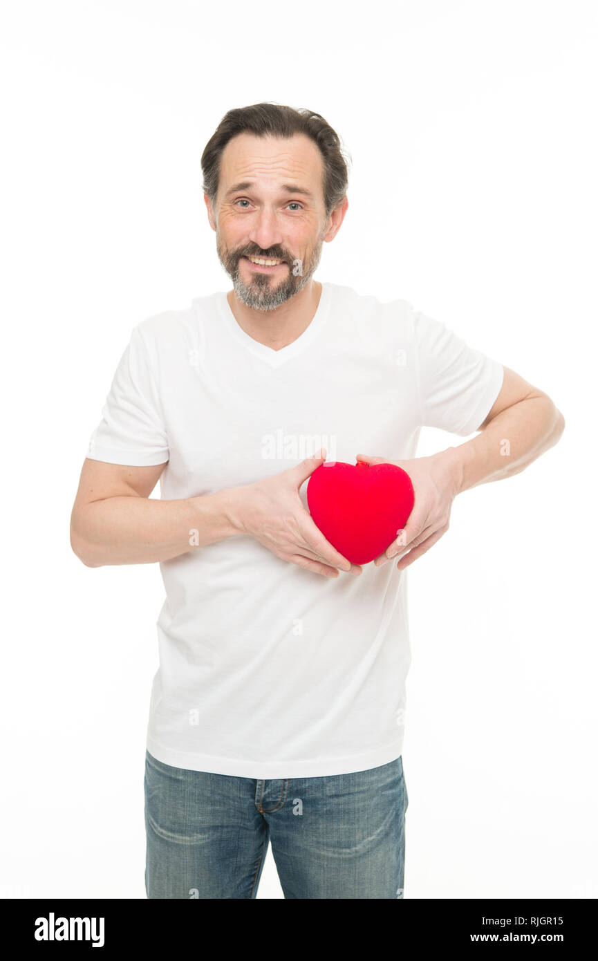 Preventing heart attack. Valentines man holding red toy heart in hands. Handsome mature man with valentines day heart. Heart problem and healthcare. Maybe this heartache will be good for him. - Stock Image