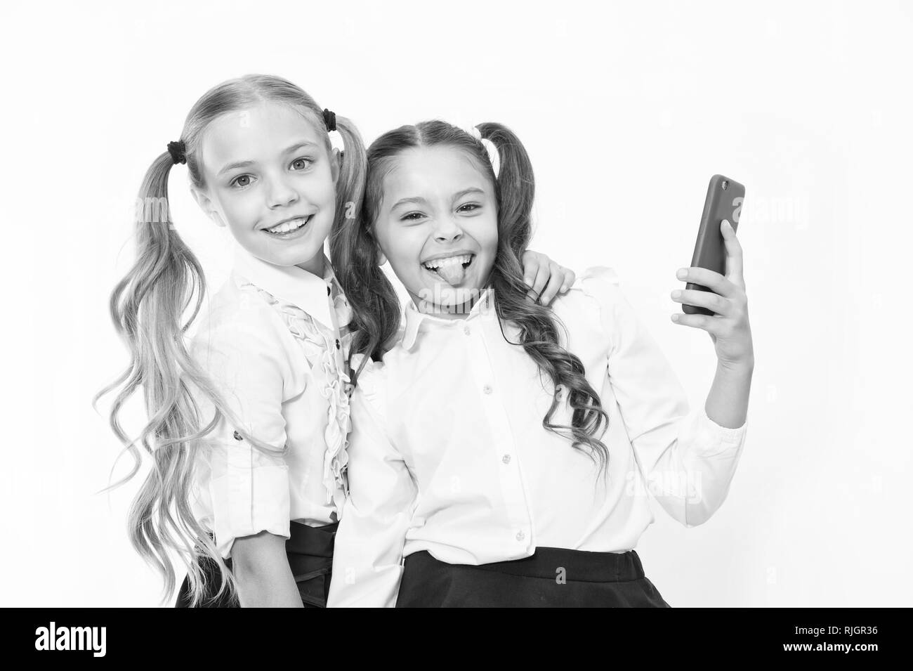 Happy girls smile with 4g mobile phones. Using 4g of wireless mobile telecommunications technology. - Stock Image