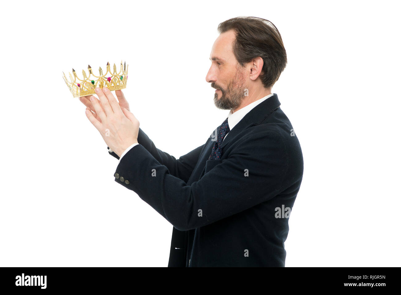 King attribute. Become next king. Monarchy family traditions. Man nature bearded guy in suit hold golden crown symbol of monarchy. Direct line to throne. Enormous privilege. Become king ceremony. - Stock Image