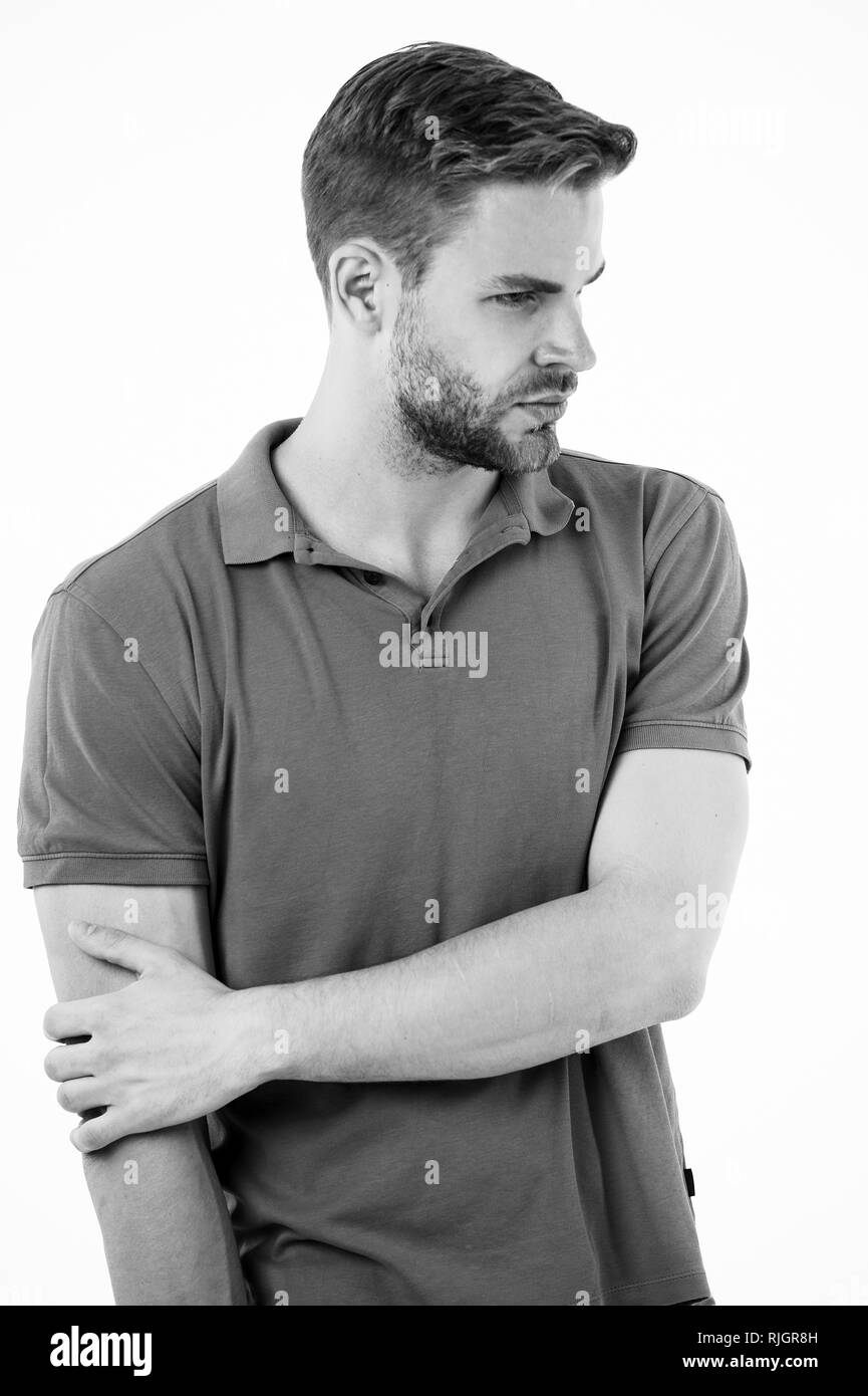 Athlete injured elbow joint. Man suffers old trauma chronic pain elbow white background. Sportsman risks taker exercising physical trauma. Guy painful face touches injured elbow. Feeling pain again. - Stock Image