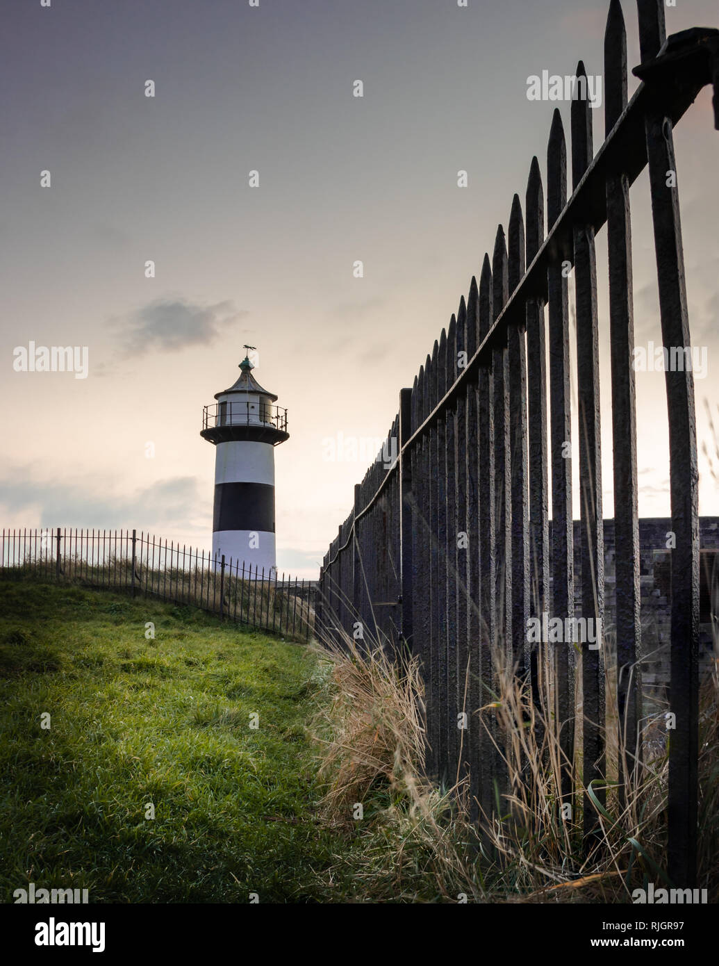 Southsea castle at sunrise with old lighthouse - Stock Image