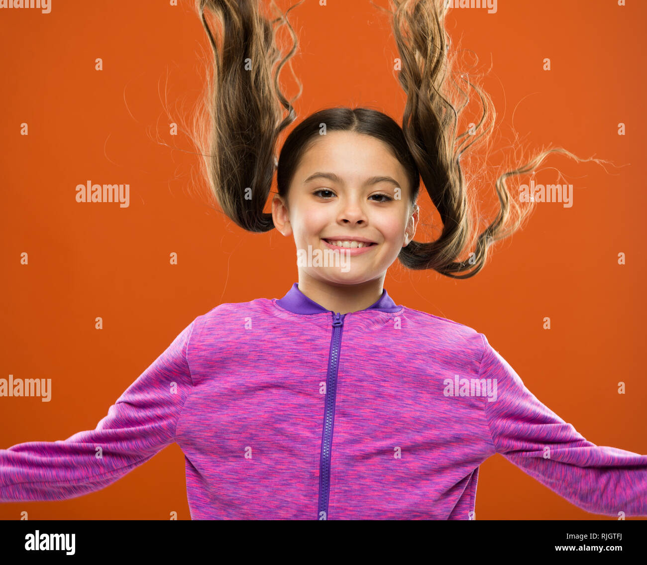 Strong And Healthy Hair Concept How To Treat Curly Hair Easy Tips Making Hairstyle For Kids Comfortable Hairstyle For Active Lifestyle Charming Beauty Girl Active Kid With Long Gorgeous Hair Stock Photo