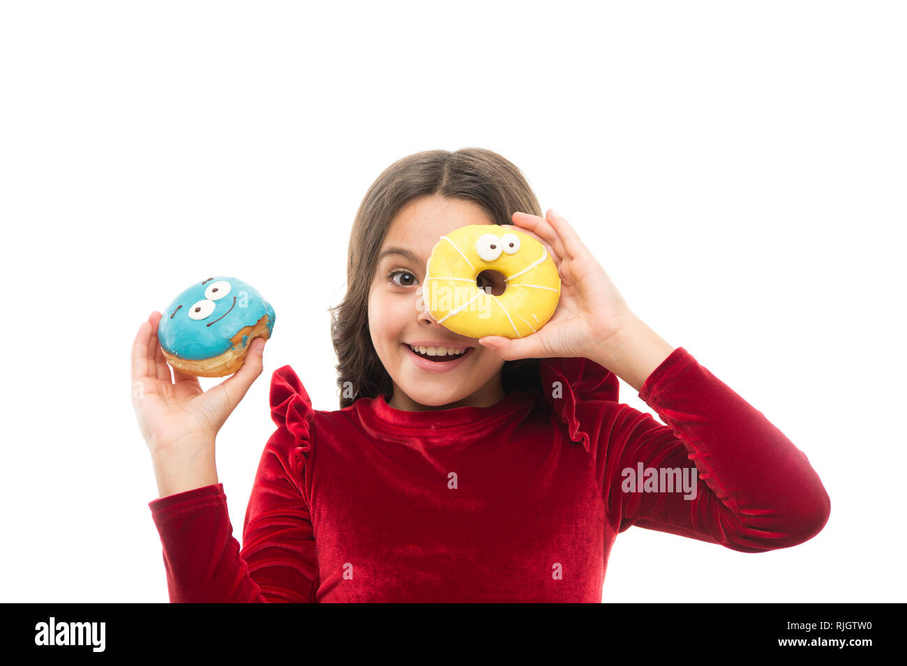 Girl hold sweet donut white background. Child hungry for sweet donut. Sugar levels and healthy nutrition. Nutritionist advice. Sweet obsession. Happy childhood and sweet treats. Breaking diet concept. - Stock Image