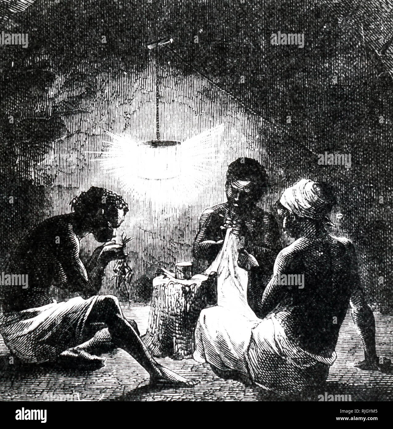 An engraving depicting West Indians using a cage of luminous beetles to provide light. Dated 19th century - Stock Image