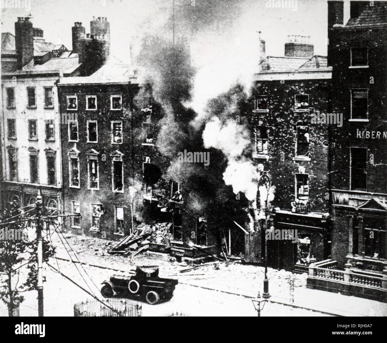 A photograph showing the method of burning out a rebel stronghold during the uprising in Ireland. Dated 20th century - Stock Image