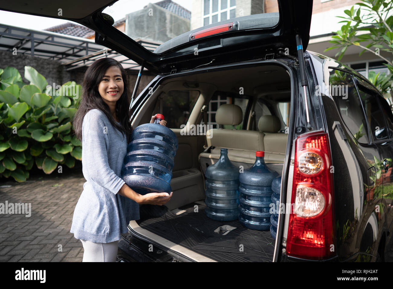 buying a new gallon of water - Stock Image