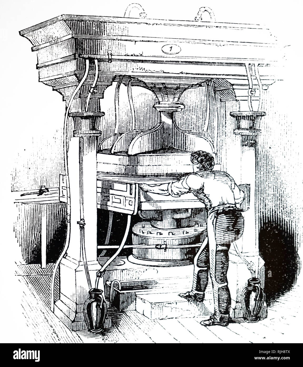 An engraving depicting a hydraulic press for printing bandanas (handkerchief squares). Dated 19th century - Stock Image