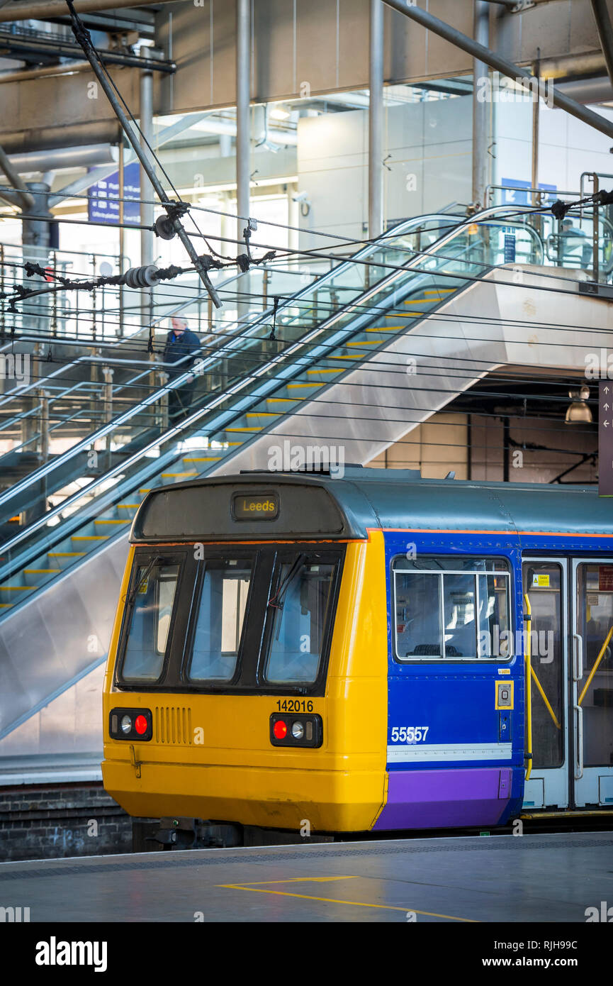 Class 142 train in Northern Rail livery waiting at Leeds railway station in England. - Stock Image