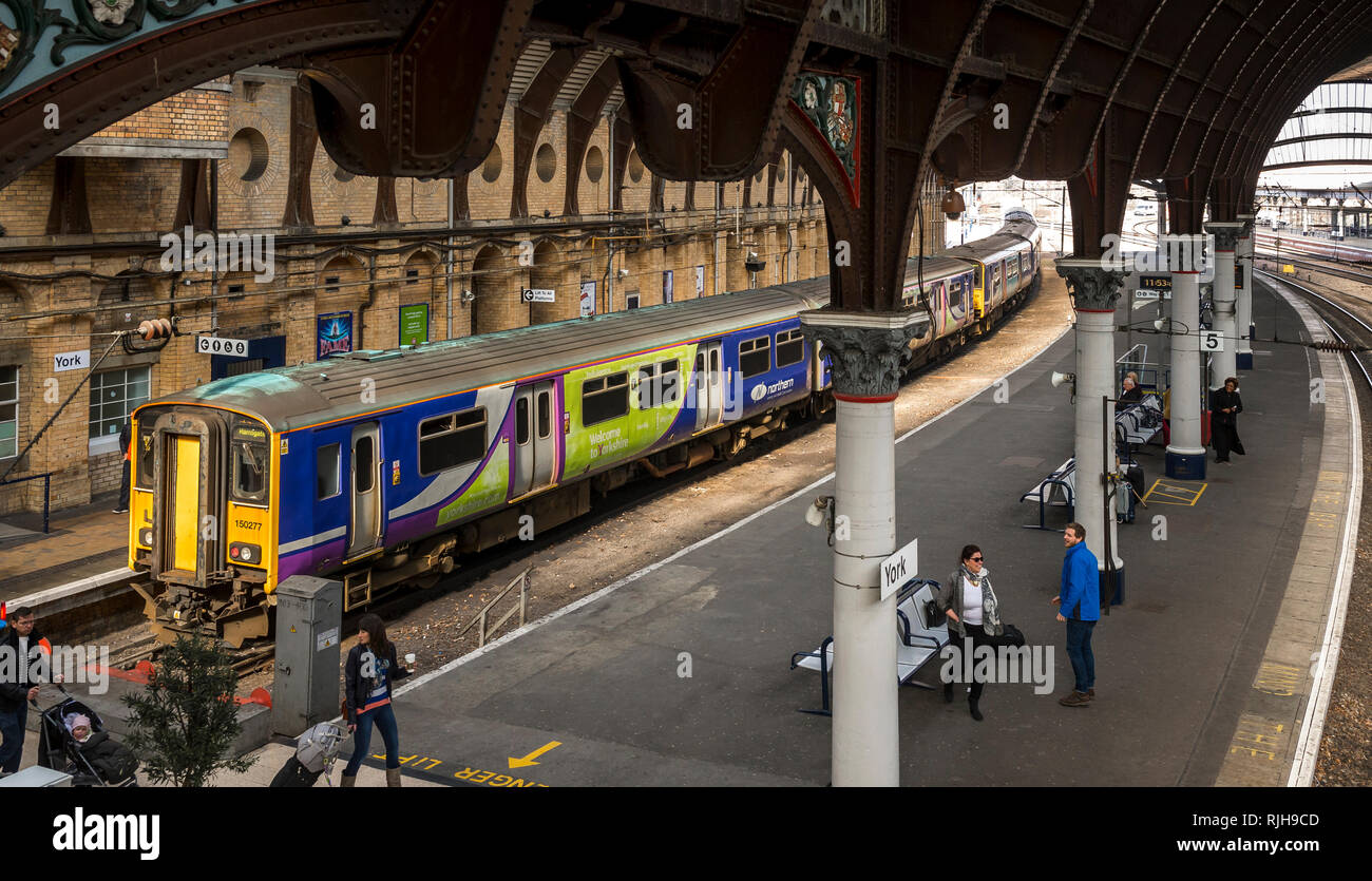 Class 150 passenger train in Northern livery waiting at York railway station, England. - Stock Image