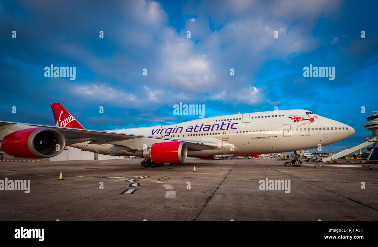 Virgin Atlantic Boeing 747-400 Jumbo Jet waiting on the apron at Gatwick Airport at dusk. - Stock Image