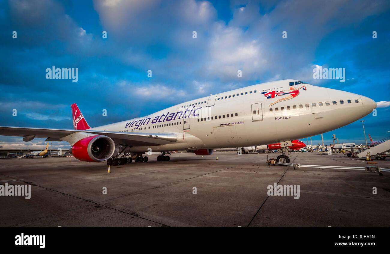 Virgin Atlantic Boeing 747-400 Jumbo Jet waiting on the apron at Gatwick Airport at dusk. Stock Photo
