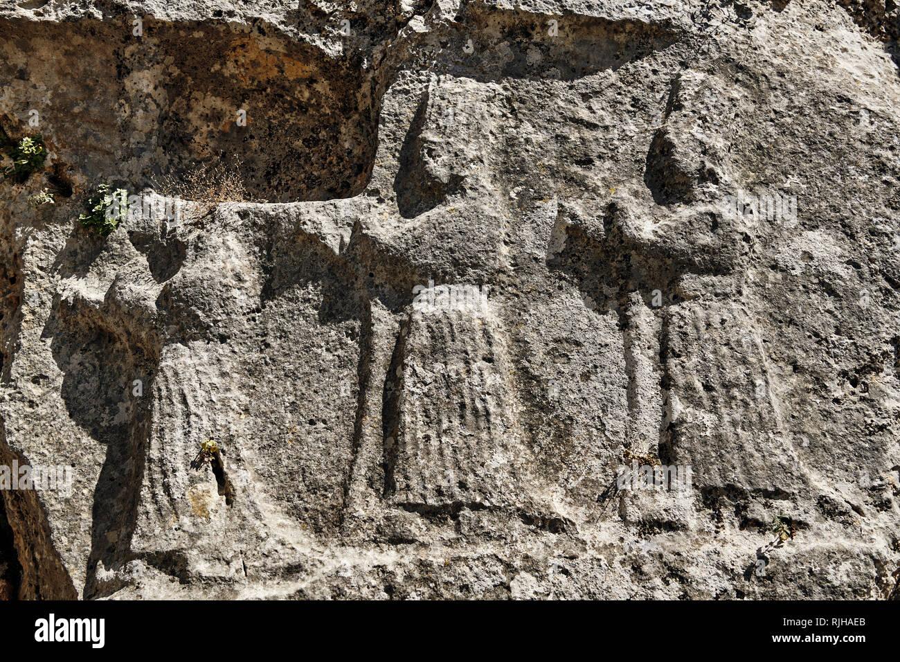 Procession of female Gods in the 13th century BC Hittite religious rock carvings of Yazılıkaya Hittite rock sanctuary, chamber A,  Hattusa, Bogazale,  - Stock Image