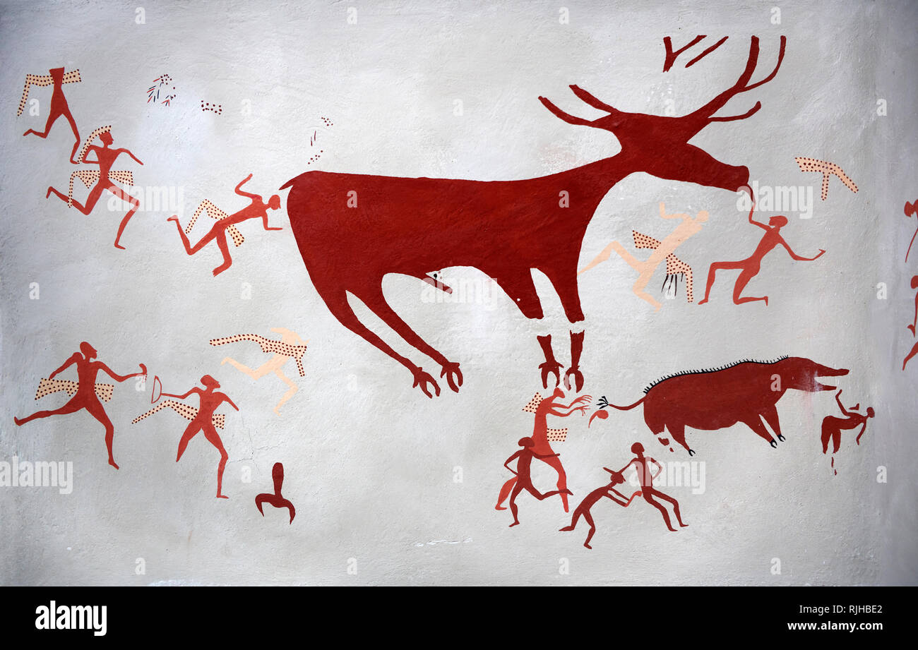 Close up of a recontructed fresco of an original found at Catalhoyuk. The men are hunting a deer and pulling on its tounge to disable it. The hunters  - Stock Image