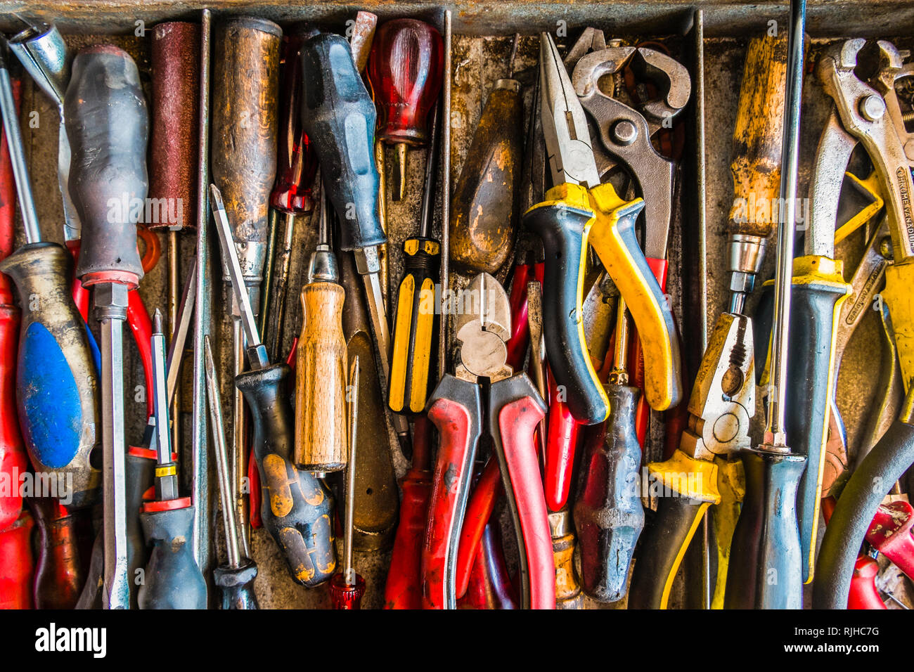 old, used tools in a toolbox Stock Photo