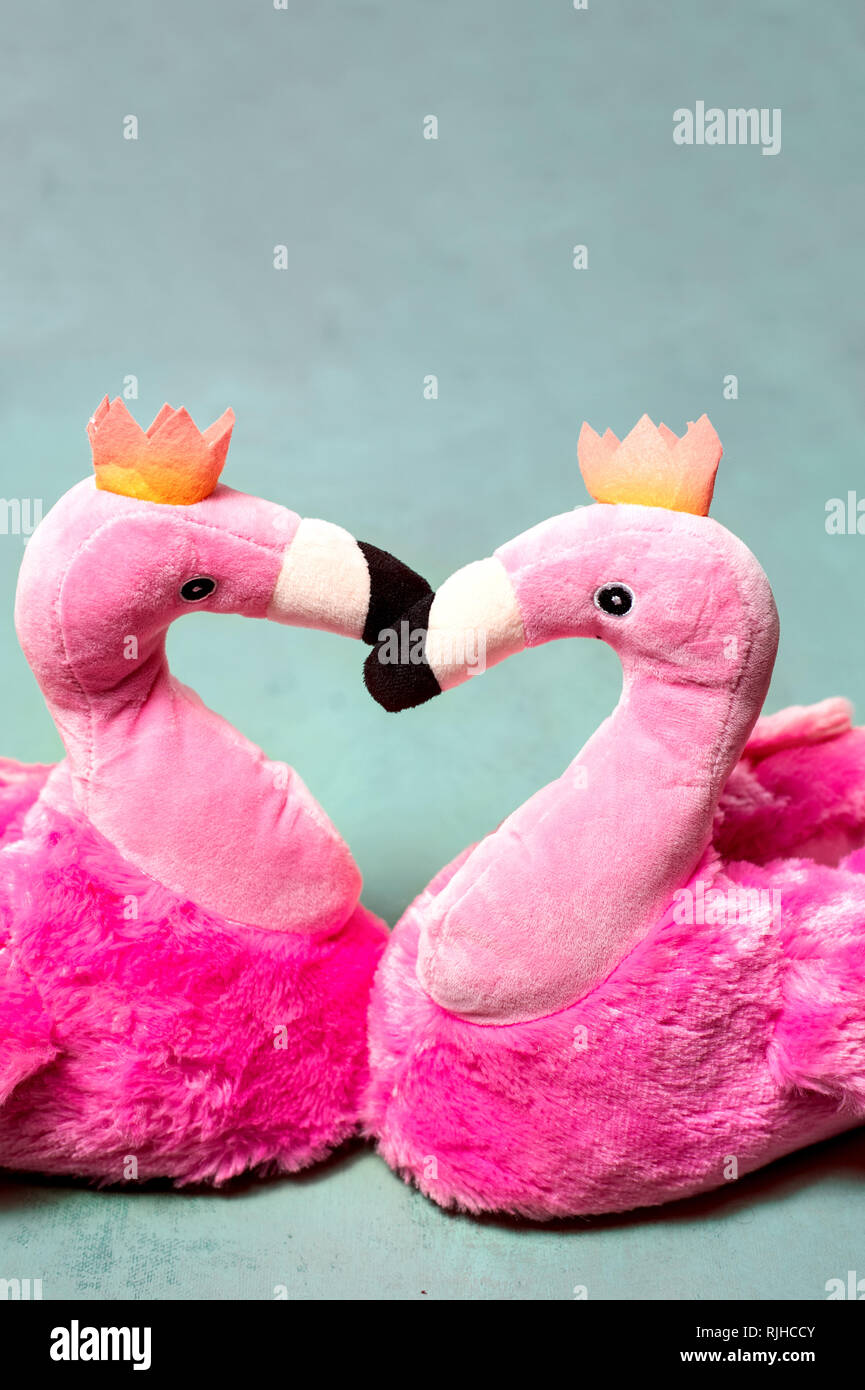 Pink Slippers with flamingo design - Stock Image