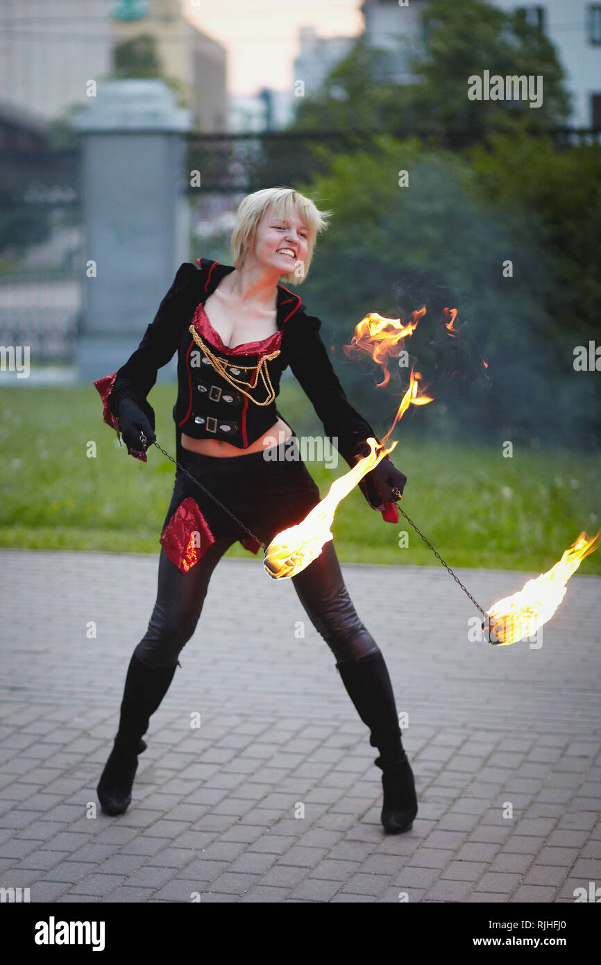 Fakir girl playing with fire on fire show - Stock Image