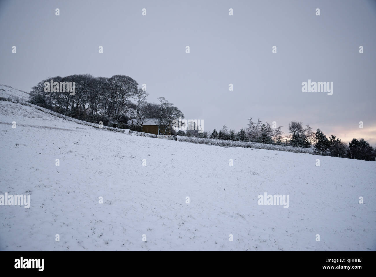 Snowy dawn in the Peak District National Park, England. Twilight light. - Stock Image