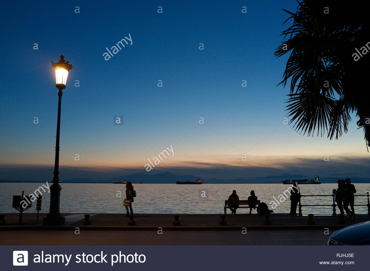 Winter sunset by the waterfront in the city of Thessaloniki, Central Macedonia, Greece. Stock Photo