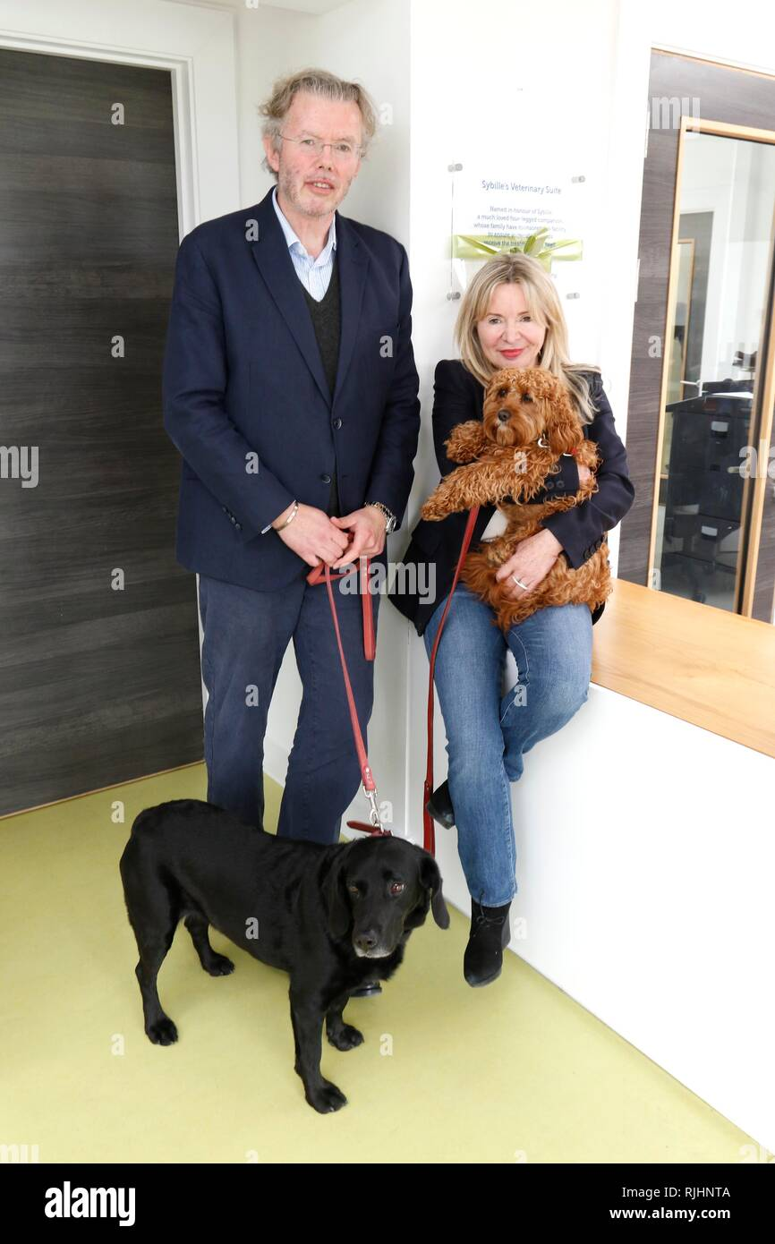 Julia and Hans Rausing with their dogs Sybille, the black lab, and Billy. Julia and Hans Rausing visit the RSPCA South Cotswolds Branch Cotswolds Dogs - Stock Image