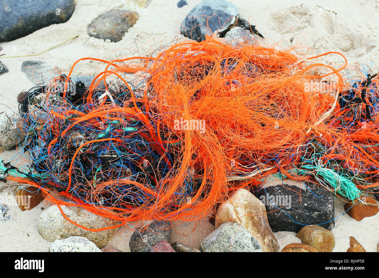 Plastic waste on the beach - Stock Image