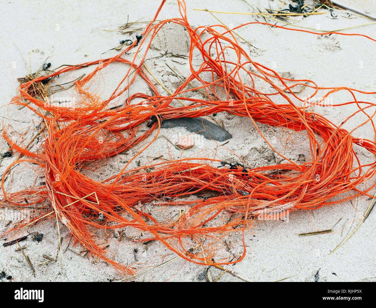Plastic garbage of fishing nets at the North sea coast - Stock Image