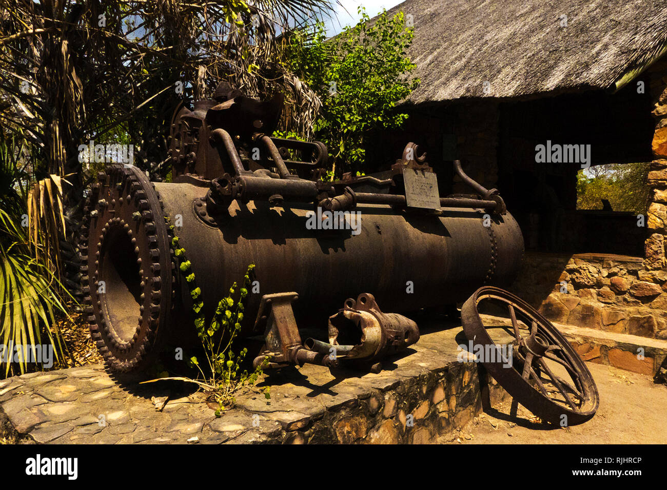 The rusting remains of an old steam traction engine used by German troops to haul a 10inch naval canon around the bush during the East Africa campaign - Stock Image