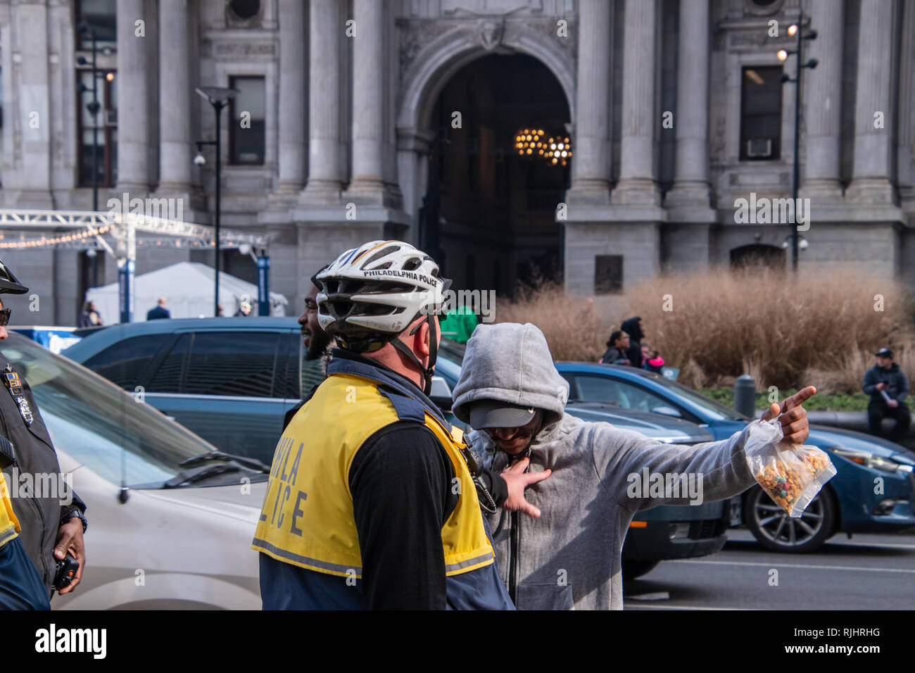 Philadelphia, Pennsylvania - February 5, 2019: Caucasian police officer is seen pushing an unruly black male during a protest in front of city hall ne - Stock Image