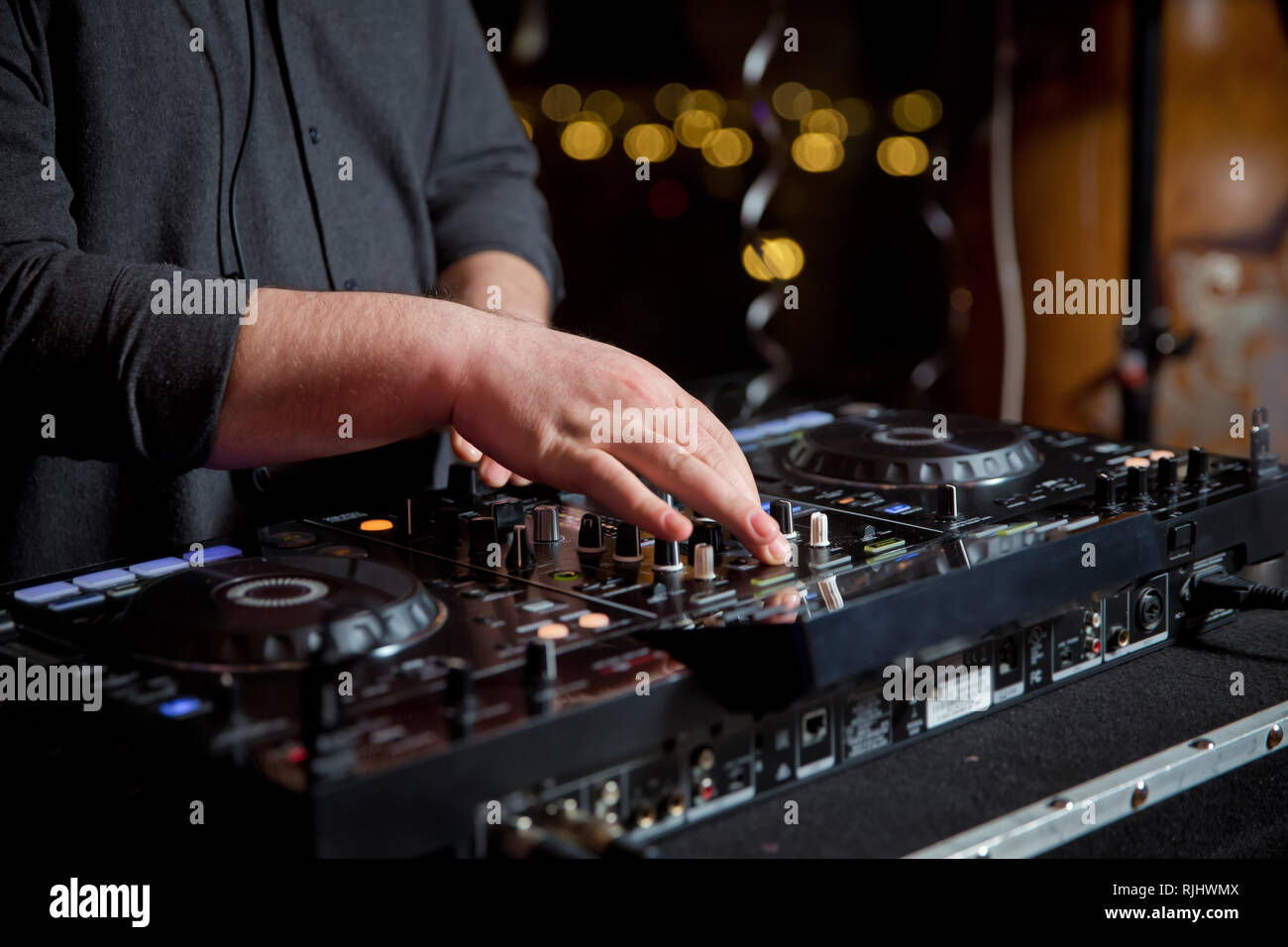 Dj mixes the track in the nightclub at party  Headphones in