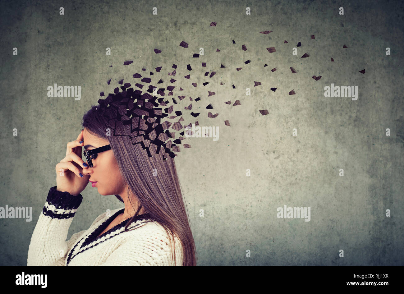 Memory loss due to dementia or brain damage. Side profile of a woman losing parts of head as symbol of decreased mind function. - Stock Image