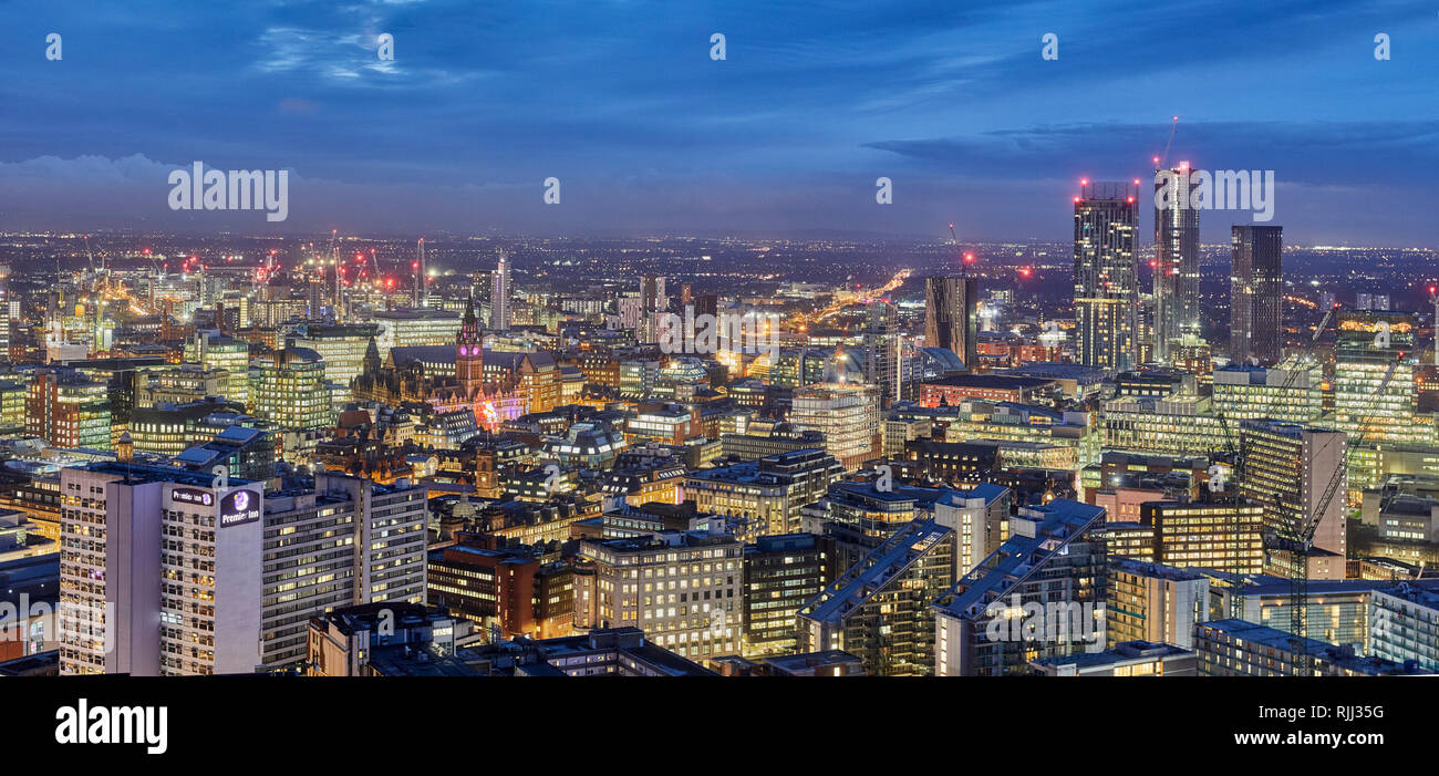 Manchester city centre skyline panoramic view across the rooftops from Salford from Wilburn, Town hall clock tower at City Tower - Stock Image