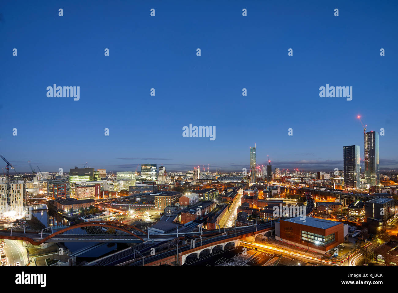 Manchester city centre skyline view across the rooftops from Salford  Beetham Tower, Liverpool Road, and MOSI Museum of Science and Industry site Stock Photo