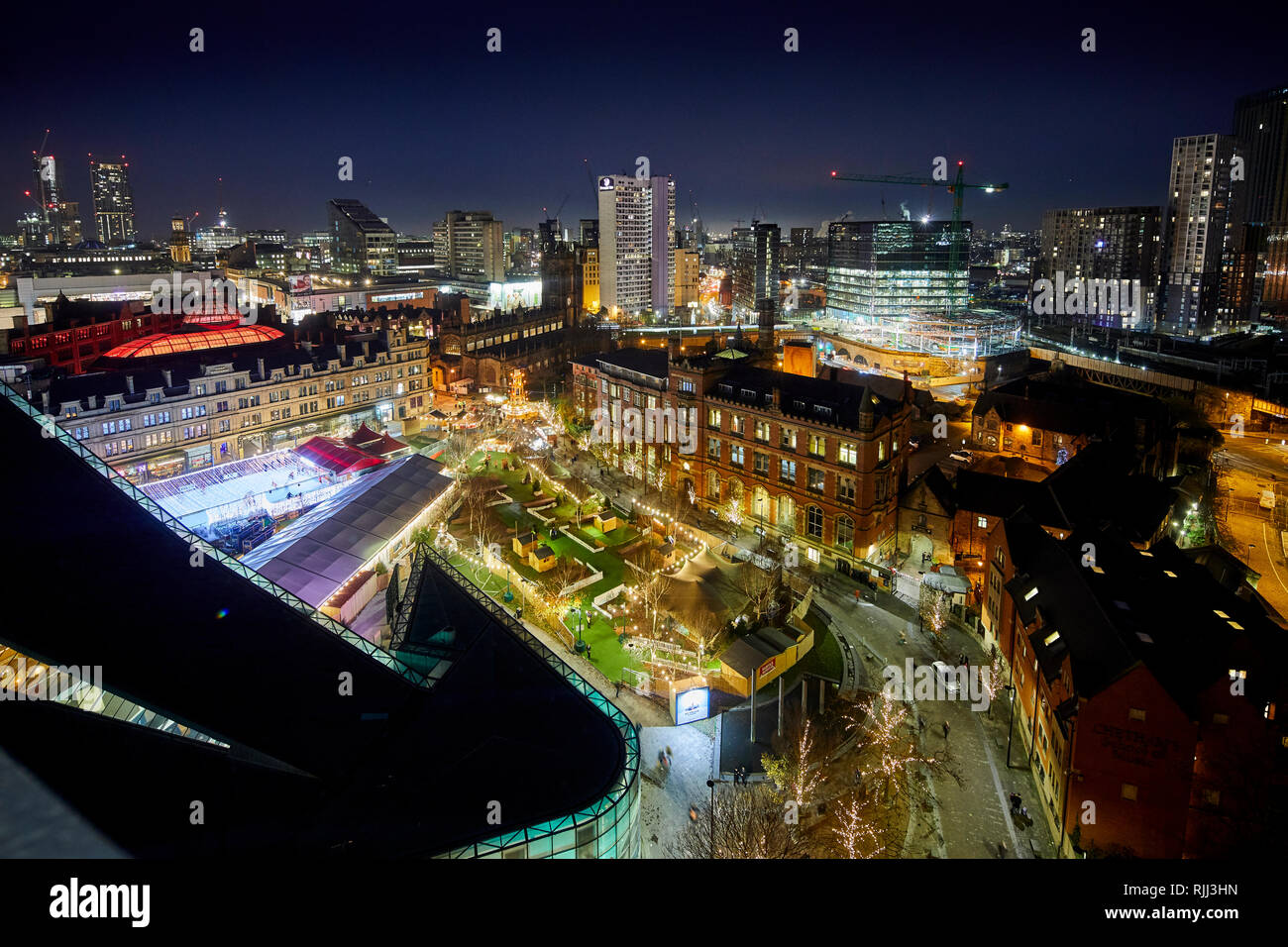 Manchester city centre skyline view across the rooftops from Hotel Indigo showing Urbis, Cathedral gardens, Corn Exchange - Stock Image