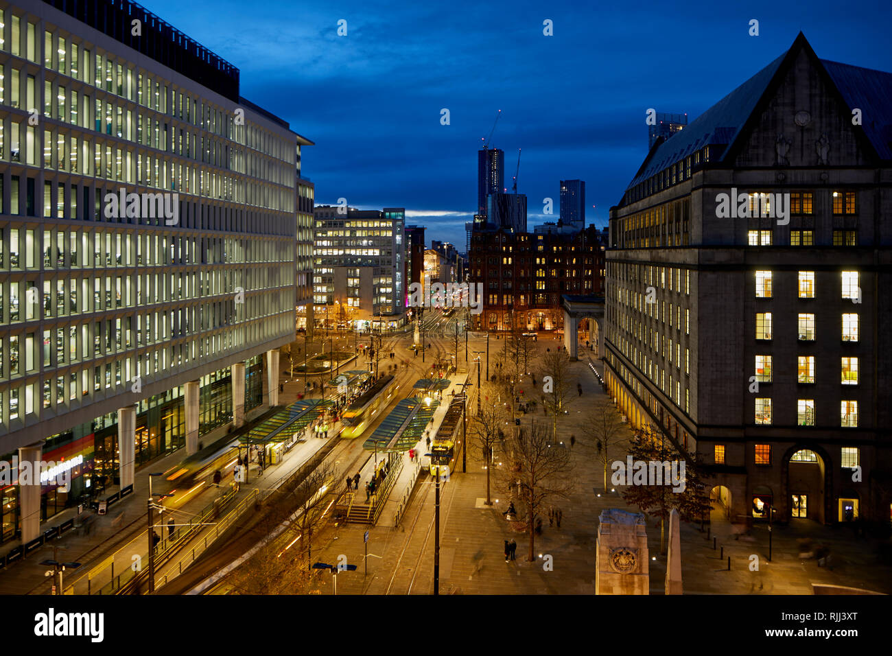 View from hunters Education into St Peters Square Metrolink tram interchange and modern public open pedestrian space at the back of Manchester Town Ha - Stock Image