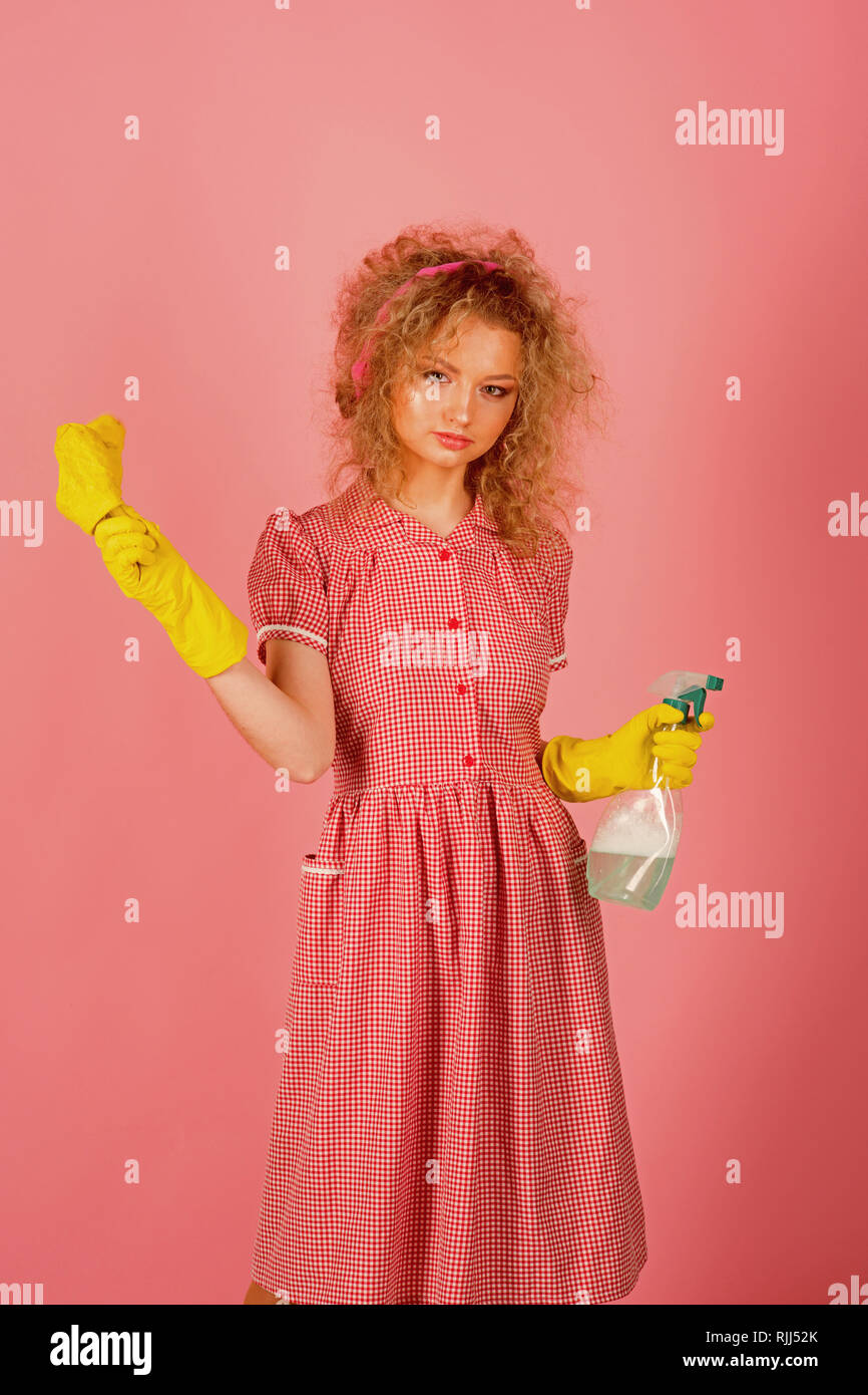 Pretty woman ready to do housework. Housework helper in rubber gloves with cloth and sprayer bottle. Extreme clean - Stock Image