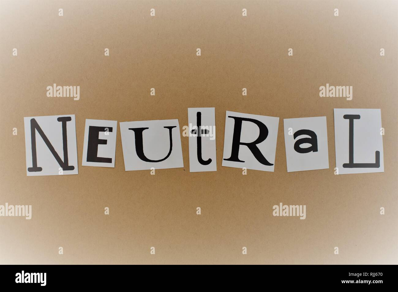 The word 'neutral' spelled out in cut out letters. - Stock Image