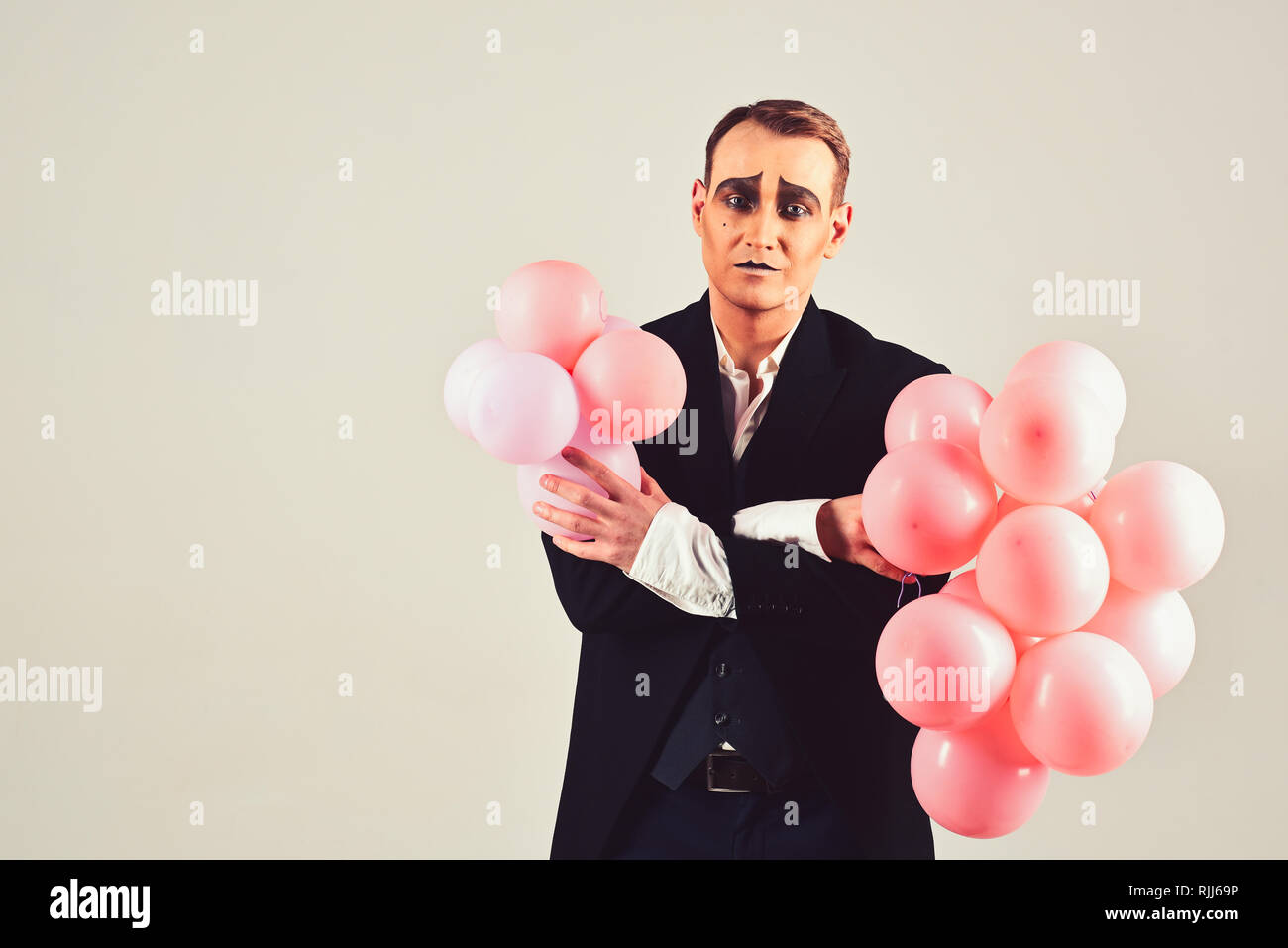 Special day to celebrate. Mime man with party balloons. Balloon artist. Man with mime makeup on birthday party. Happy birthday or anniversary - Stock Image