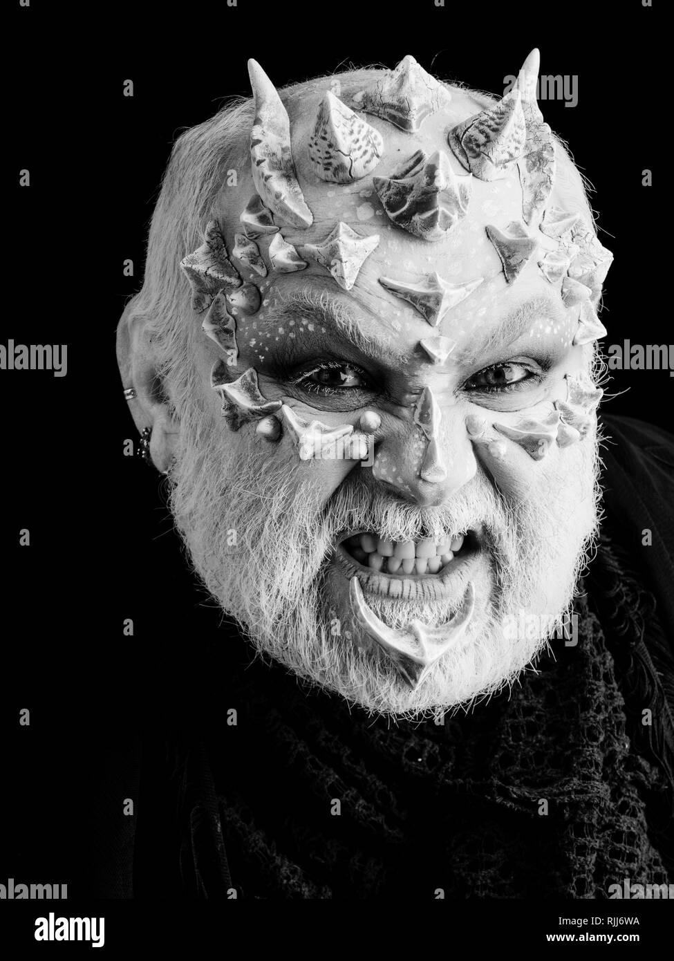 Angry monster man baring teeth - Stock Image