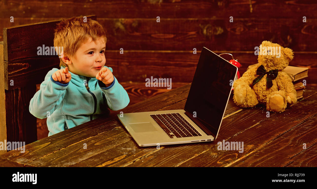 Genius kid. Genius child with laptop. Genius boy with computer. Genius technology for future. Point in the right direction - Stock Image