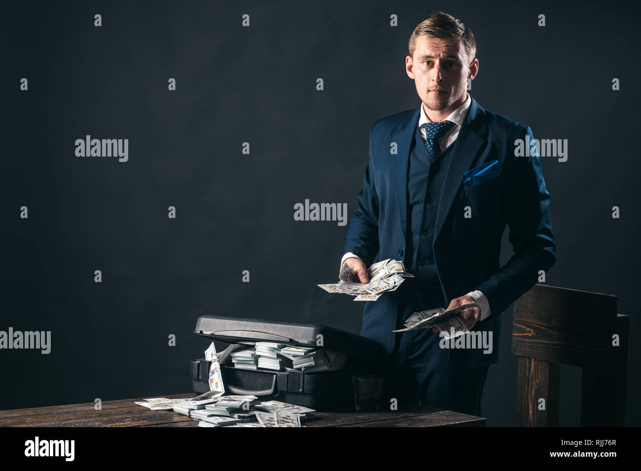 Economy and finance. Man bookkeeper. Businessman work in accountant office. Money transaction. Man in suit. Mafia. Making money. Small business - Stock Image