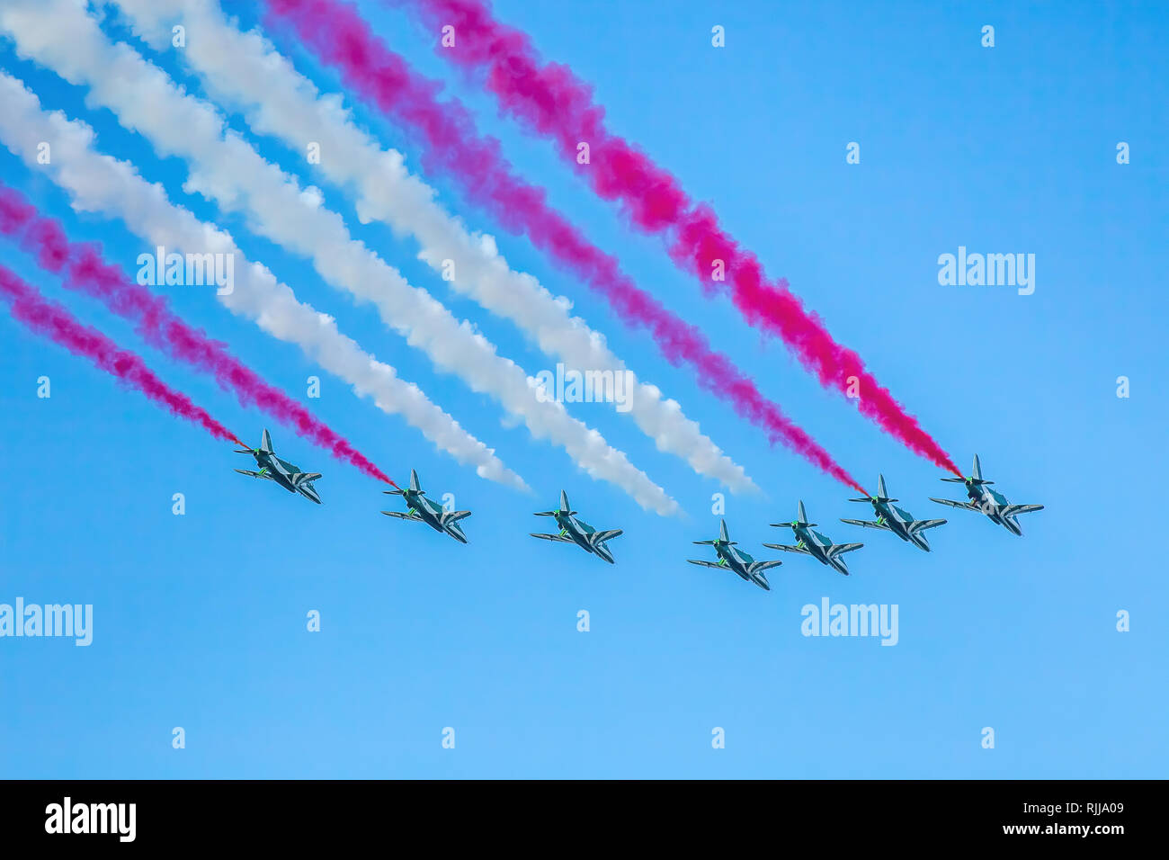 Abu Dhabi, United Arab Emirates, December 2, 2016: Al Fursan aerobatics team fly past in formation on National Day. Stock Photo
