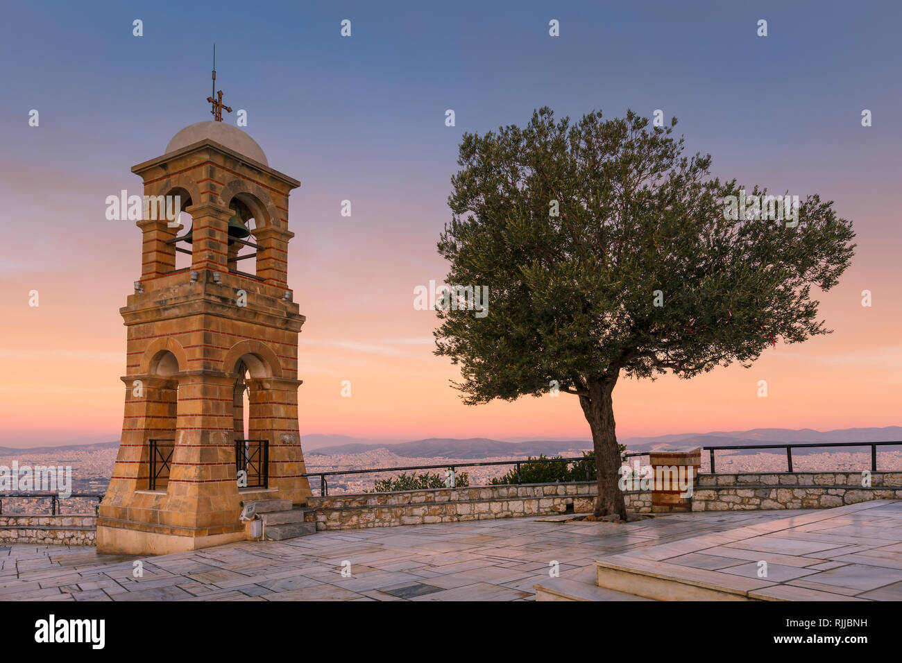 Bell tower of the 19th century Chapel of St. George on the summit of Lycabettus hill in Athens, Greece. - Stock Image