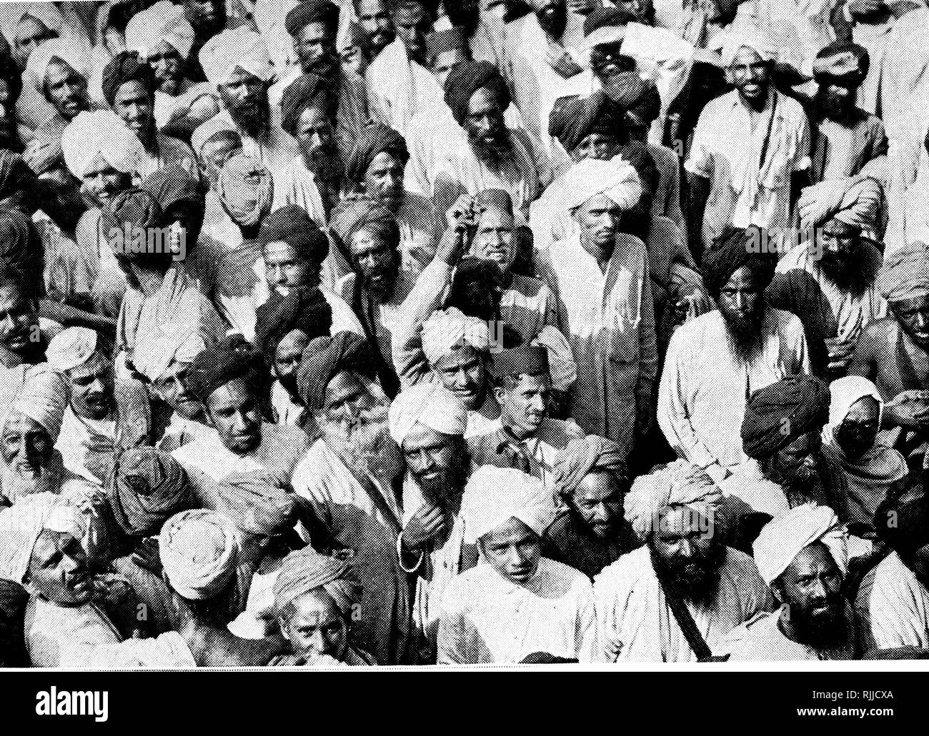 A photograph taken during the Gandhi movement in India. People crowd the streets of Amritsar to watch a demonstration of the disciples of Gandhi. Dated 20th century - Stock Image