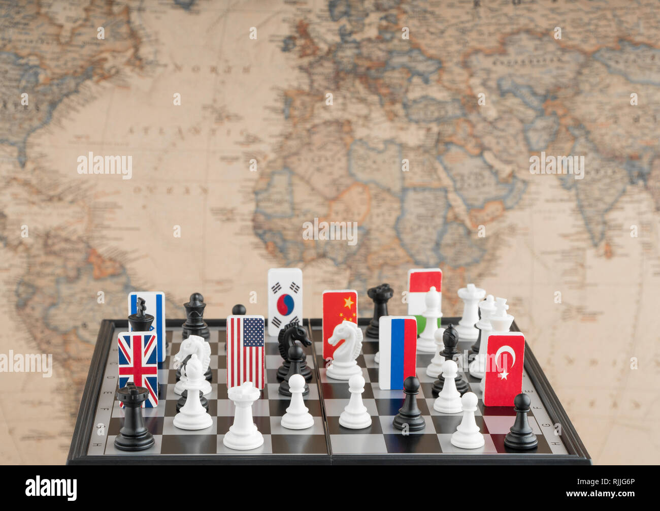 Country flag symbols on the chessboard with figures on the ...