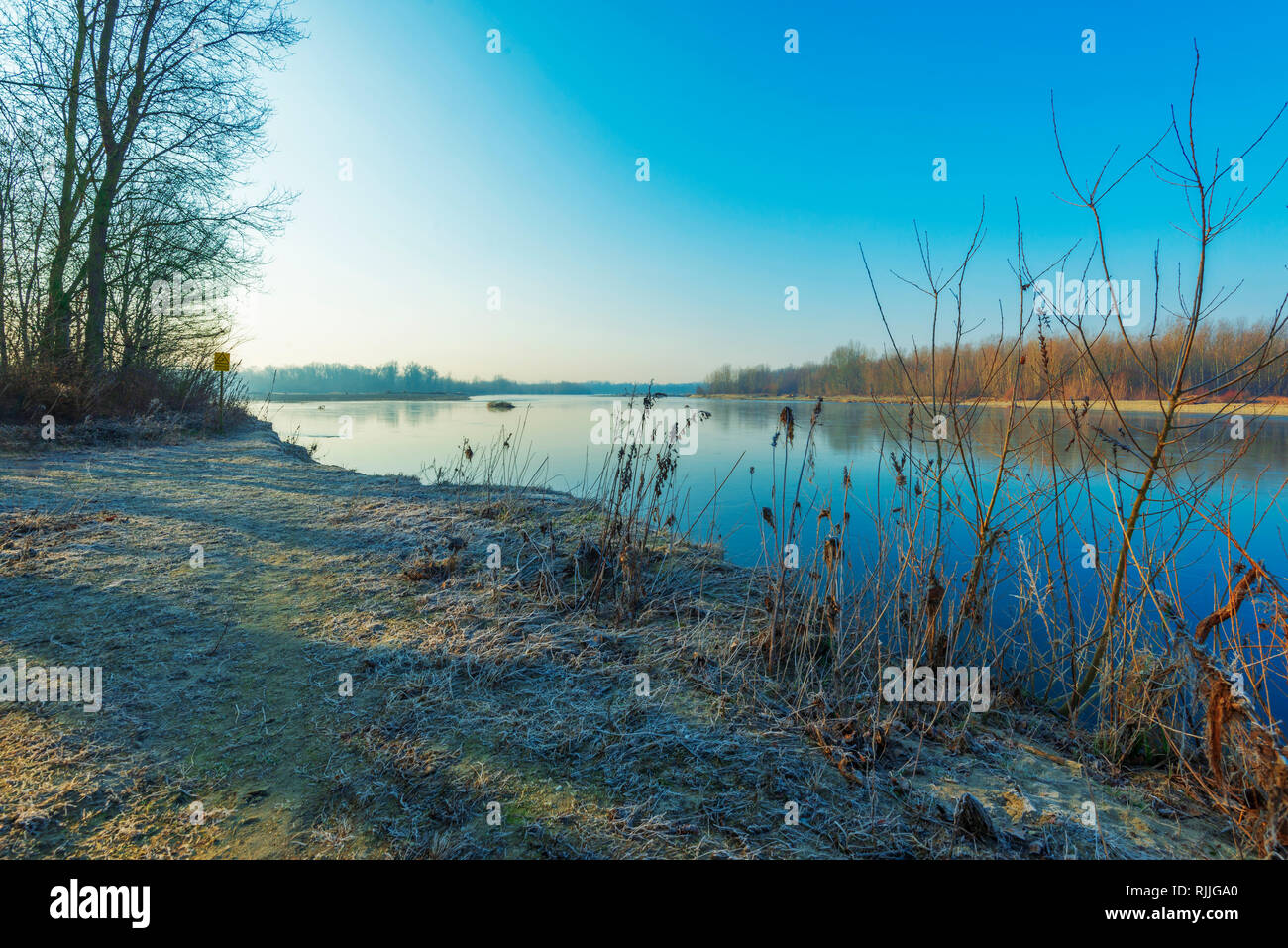 a winter sunrise in a sunny morning over the Ticino river - Stock Image