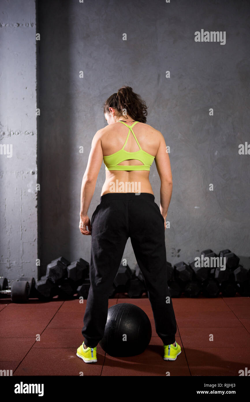 Theme sport and health  A strong muscular Caucasian woman in