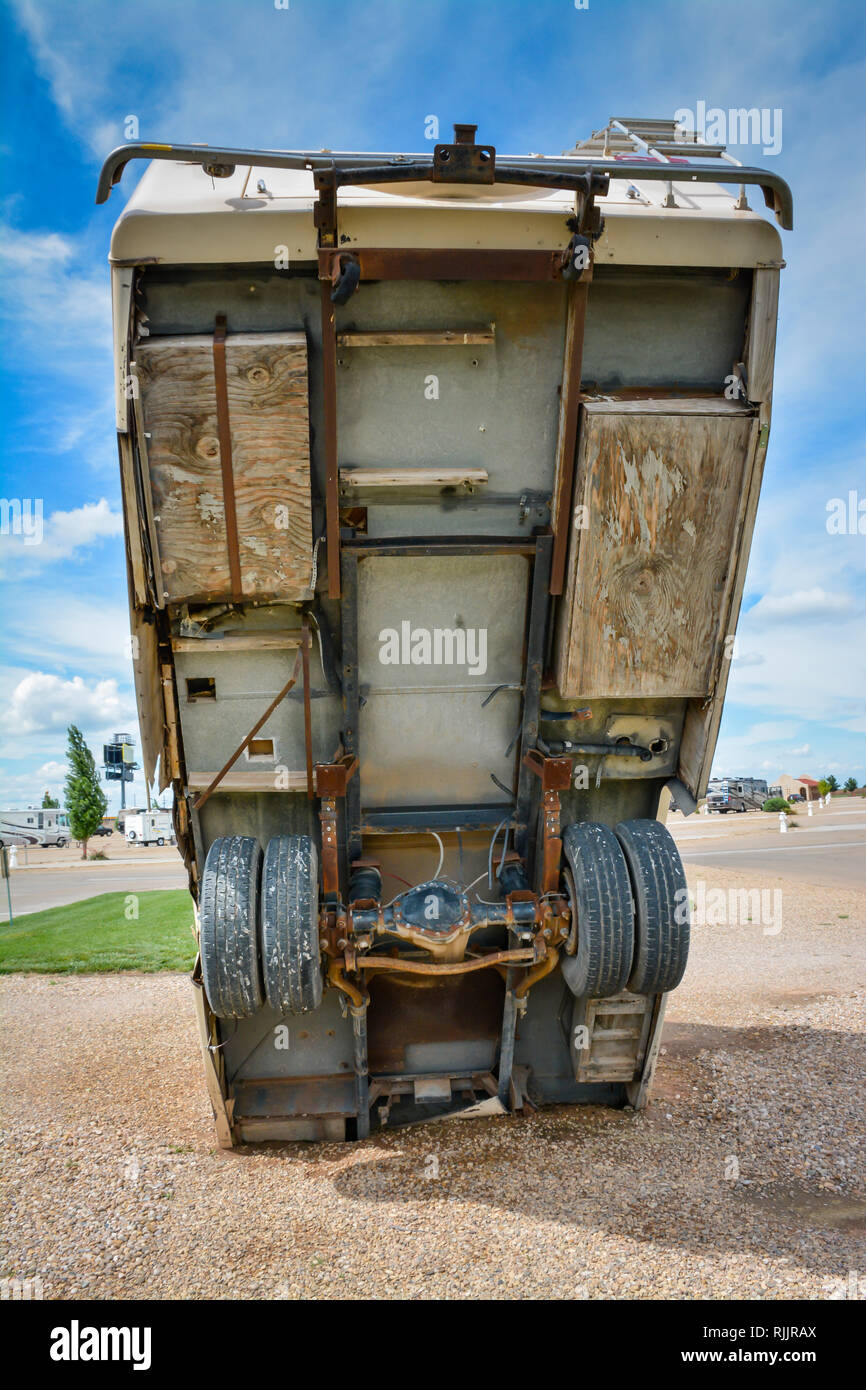 An unlikely view underneath a half-buried RV as a roadside attraction outside of Amarillo, TX - Stock Image